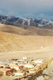 Scenery of snow mountains and tibetan village Stock Photo