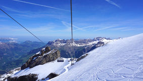 Scenery of snow mountains titlis and cable car Stock Photography