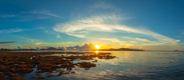 Scenery sunrise above the coral reef. coral reef emerges from the water at a reduced water level. During low tide we can see a lot of coral reef and marine royalty free stock photo