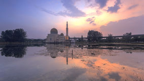 Scenery of sunrise at a Mosque with reflection stock images