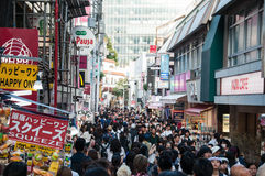 Scenery of Takeshita Street. Near Harajuku station, Tokyo Prefecture, Japan. People walk around shops while shopping. This street is really famous for fashion royalty free stock photos