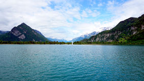 Scenery of Thun Lake and sail boat Stock Photos