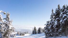 Scenery from the top of Sun Peaks overlooking a cloud covered valley Stock Image