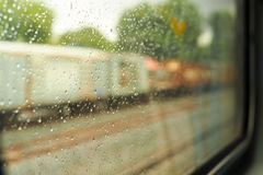 Scenery from the train window after the rain. Train travel When it is raining Stock Photos