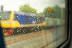 Scenery from the train window after the rain. Travel by train when it rains plainly Royalty Free Stock Image