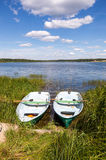 Scenery with two wooden boat in summertime Royalty Free Stock Photos