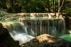 Scenery view. beautiful waterfall among the tree in the forest a. Scenery view. beautiful waterfall among the tree in the deep forest are background. this image Stock Photos