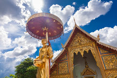 Scenery view golden Buddhist monk statue in Buddha Thailand Temple Stock Image