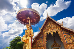 Scenery view golden Buddhist monk statue in Buddha Thailand Temple Royalty Free Stock Photos