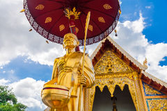 Scenery view golden Buddhist monk statue in Buddha Thailand Temple Royalty Free Stock Photography