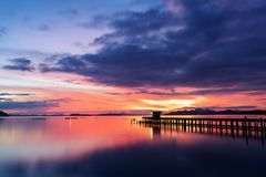 Scenery view of old jetty to the sea beautiful sunrise or sunset Royalty Free Stock Photo