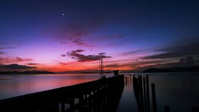 Scenery view of old jetty to the sea beautiful sunrise or sunset Royalty Free Stock Photos