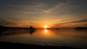 Scenery view of old jetty to the sea beautiful sunrise or sunset Stock Image