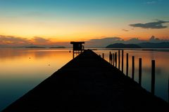 Scenery view of old jetty to the sea beautiful sunrise or sunset. In phuket thailand Royalty Free Stock Photography