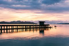Scenery view of old jetty to the sea beautiful sunrise or sunset Stock Photography