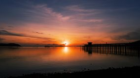 Scenery view of old jetty to the sea beautiful sunrise or sunset Stock Photos