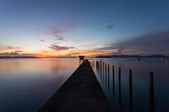 Scenery view of old jetty to the sea beautiful sunrise or sunset. In phuket thailand Royalty Free Stock Images