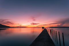 Scenery view of old jetty to the sea beautiful sunrise or sunset. In phuket thailand Royalty Free Stock Photos