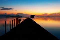 Scenery view of old jetty to the sea beautiful sunrise or sunset. In phuket thailand Stock Images