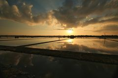 Scenery view of sunrise in the fish pond royalty free stock photos