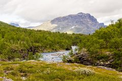 Scenery view in the Swedish north. Mountains river,. Scenery view in the Swedish north.  Kings trail, nice place for hiking, camping, being into the wild. Also Royalty Free Stock Images