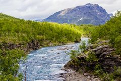Scenery view in the Swedish north. Mountains river,. Scenery view in the Swedish north.  Kings trail, nice place for hiking, camping, being into the wild. Also Stock Image