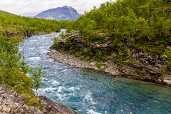 Scenery view in the Swedish north. Mountains river,. Scenery view in the Swedish north.  Kings trail, nice place for hiking, camping, being into the wild. Also Royalty Free Stock Image