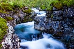Scenery view in the Swedish north. Mountains river taken with long exposure. Scenery view in the Swedish north. Kings trail, nice place for hiking, camping Stock Image