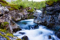 Scenery view in the Swedish north. Mountains river taken with long exposure. Scenery view in the Swedish north. Kings trail, nice place for hiking, camping Stock Photos