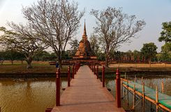Scenery of Wat Sa Si, an ancient Buddhist Temple in Sukhothai Historical Park, with the majestic Pagoda Stupa in background Royalty Free Stock Photography