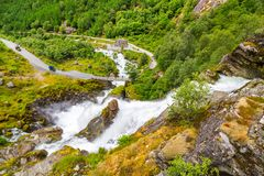 Scenery Waterfall In Briksdal Glacier In Norway. Beautiful waterfall from the meltwater of the Brixdal Glacier in Norway, bottom view. Panoramic view to stock photo