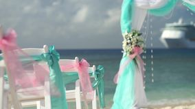 Scenery for a wedding on the beach with a cruise liner in the background stock footage