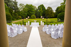 Scenery of the wedding ceremony in the park. White frame decorated with flowers. Ceremony in white style Stock Images