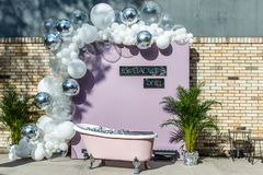 Scenery of a wedding photo zone with a bathroom and balls royalty free stock photo