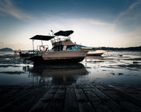 Scenery of the wooden pier with motor boat Stock Photography