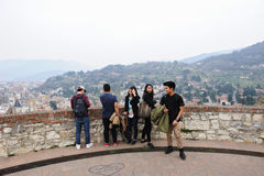 Scenes of  Brescia, Italy. BRESCIA, ITALY - MARCH 21, 2015: Tourists looking at the city from the tower Royalty Free Stock Photography