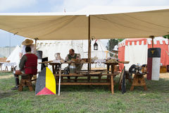 Scenes of medieval life in a camp of tents Stock Photos