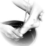 Scenetta della lavanda dei piedi Fotografie Stock