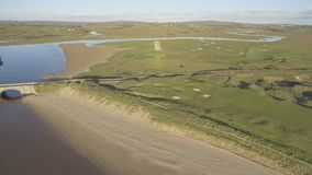 Scenic aerial birds eye panoramic irish landscape from lahinch in county clare, ireland. beautiful lahinch beach and golf course stock video footage