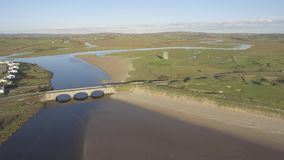 Scenic aerial birds eye panoramic irish landscape from lahinch in county clare, ireland. beautiful lahinch beach and golf course stock footage