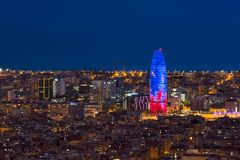 Scenic aerial view of Barcelona city skyscraper and skyline at night in Barcelona, Spain.  stock photo