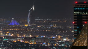 Scenic aerial view of a big modern city at night timelapse. Business bay, Dubai, United Arab Emirates. stock video
