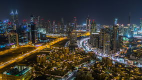 Scenic aerial view of a big modern city at night timelapse. Business bay, Dubai, United Arab Emirates. stock video footage