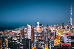 Scenic aerial view of downtown Dubai, UAE, with illuminated skyscrapers. Stock Image