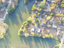 Scenic aerial view of green suburban area of Ozark, Arkansas, US. Aerial lakeside suburban area of Ozark, Arkansas, USA at sunset. Top overhead residential Royalty Free Stock Image
