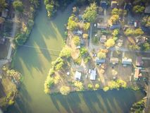 Scenic aerial view of green suburban area of Ozark, Arkansas, US. Aerial lakeside suburban area of Ozark, Arkansas, USA at sunset. Top overhead residential Royalty Free Stock Photography