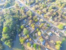 Scenic aerial view of green suburban area of Ozark, Arkansas, US. Aerial lakeside suburban area of Ozark, Arkansas, USA at sunset. Top overhead residential Stock Image