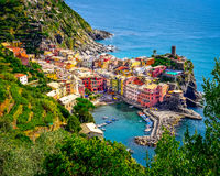 Scenic aerial view of ocean and harbor in colorful village Verna stock images