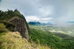 Scenic aerial view to valley in Oahu island, Hawaii at rainy cloudy day royalty free stock photography