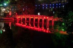Scenic Ancient Red bridge at lake in Hanoi royalty free stock image